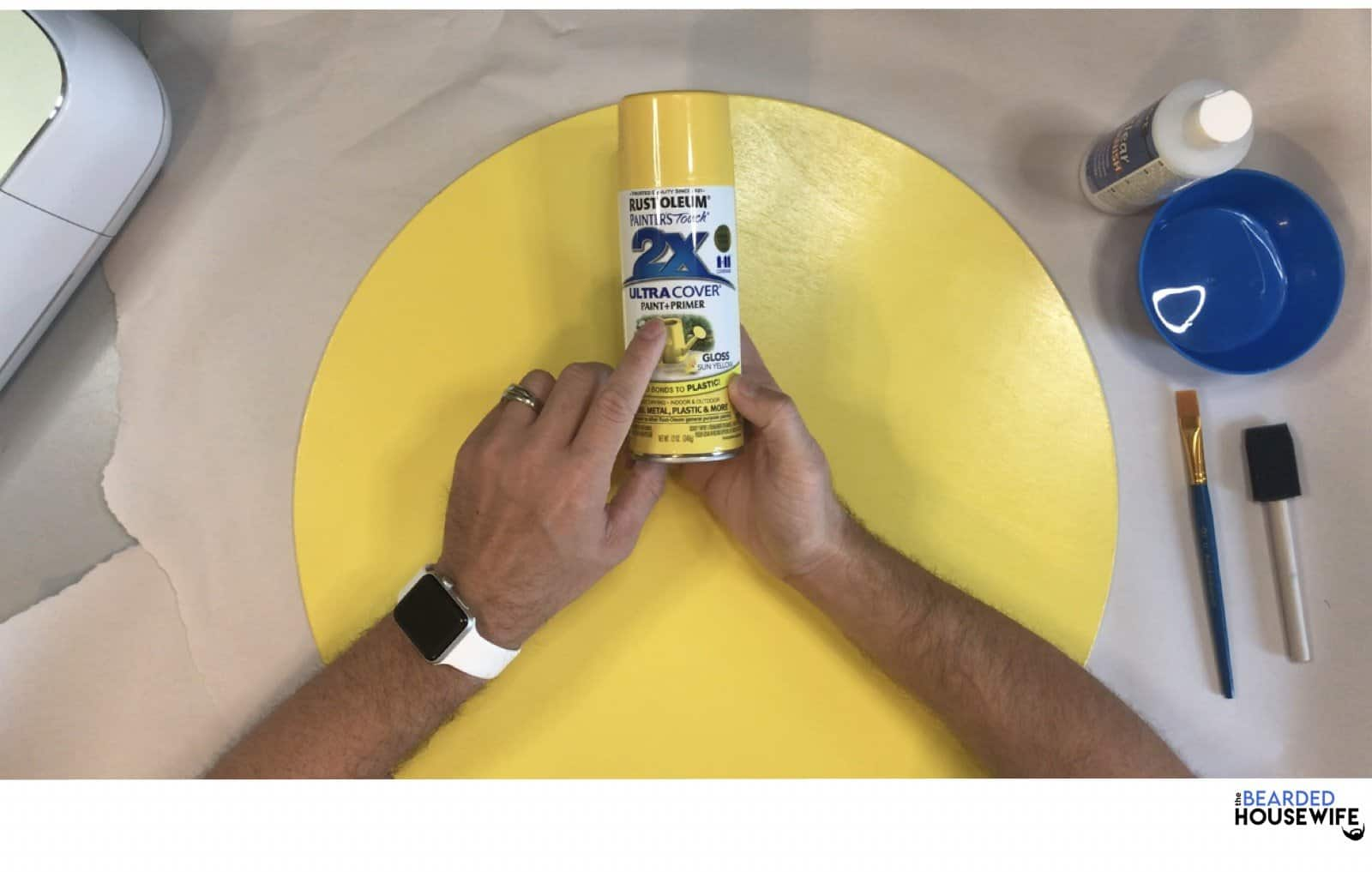 spray paint or paint your wood circle. I am using rust-o-leum spray paint