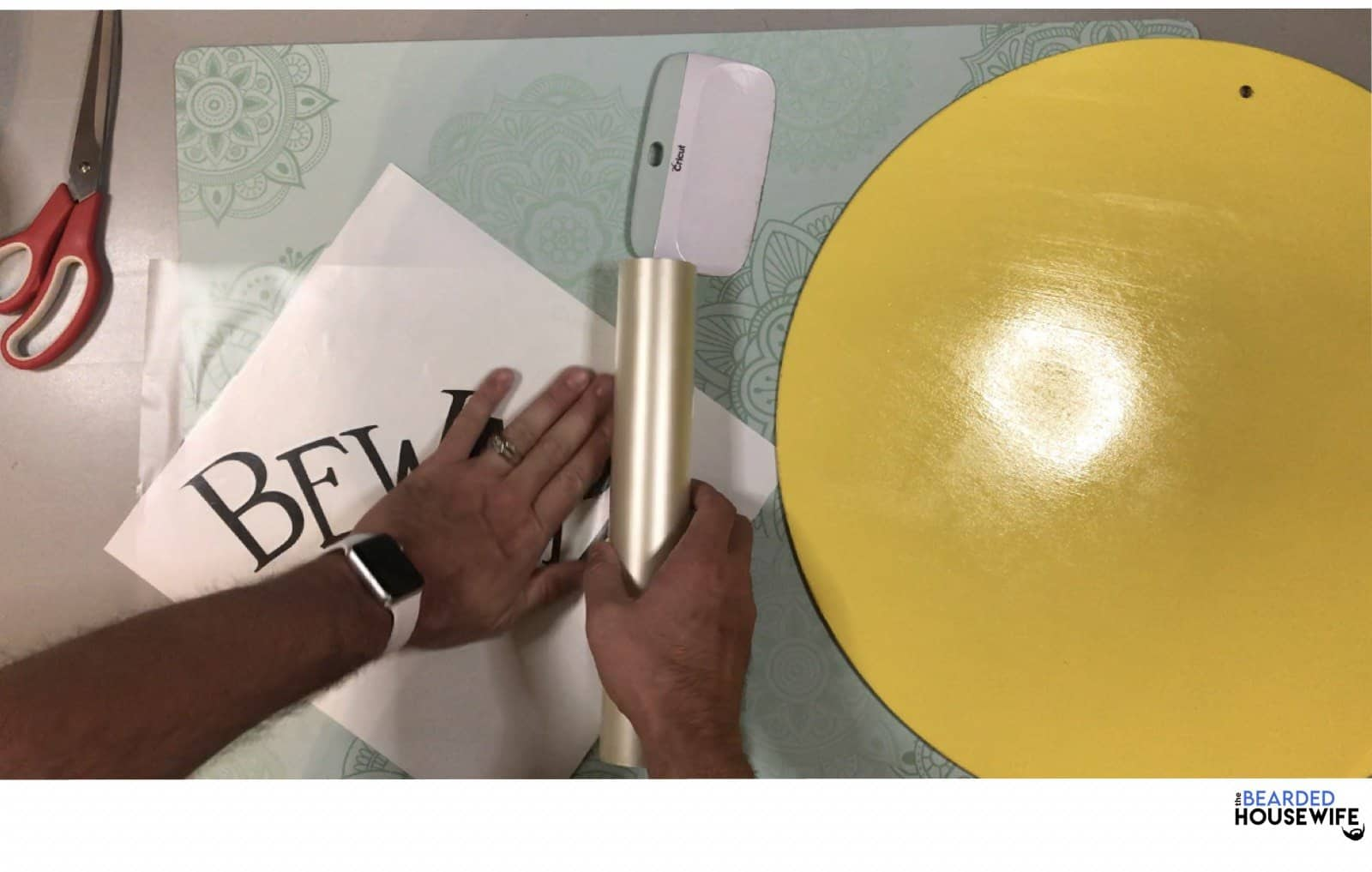 once your sign has cured, weed your vinyl and apply transfer tape to one section
