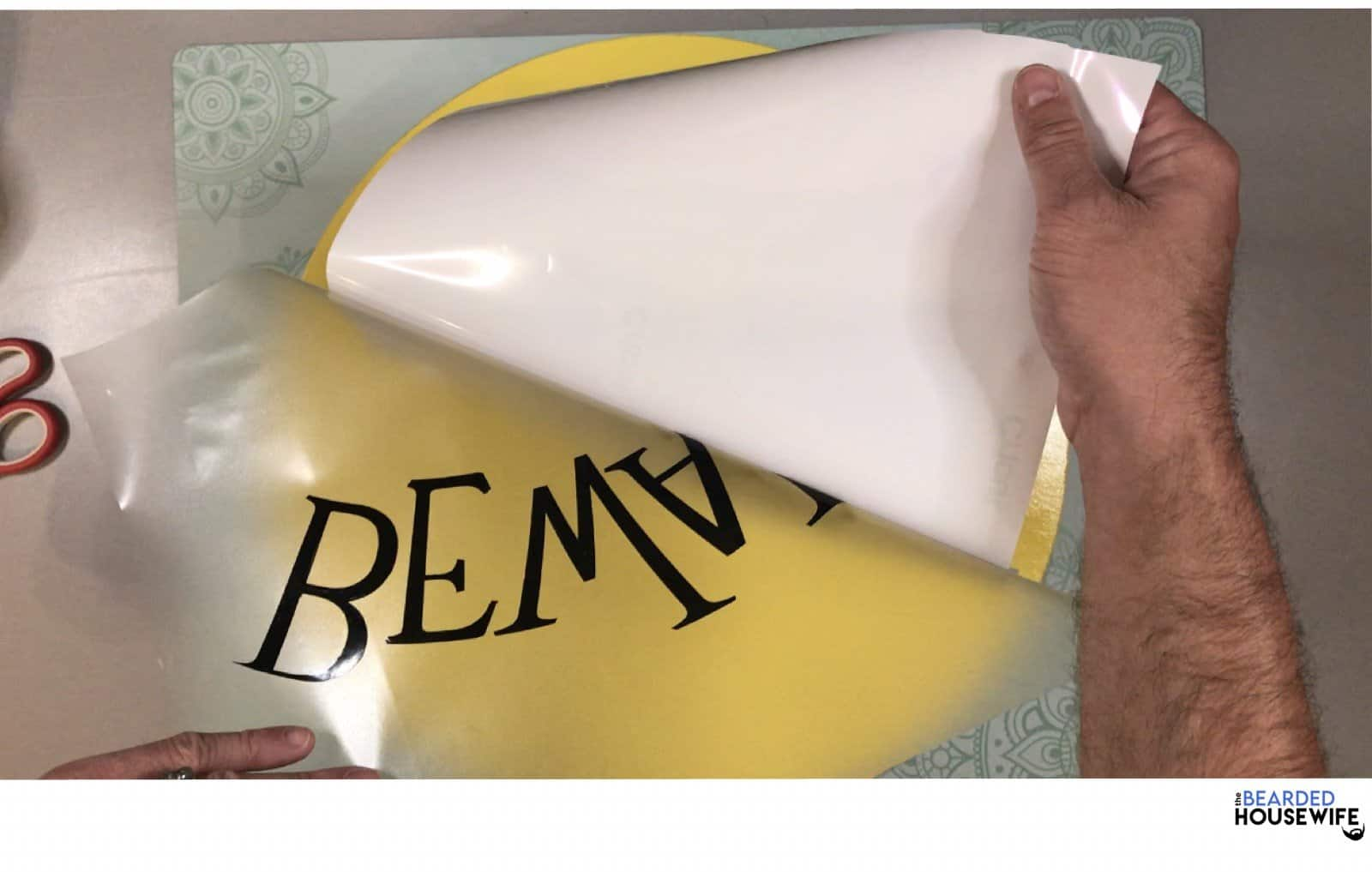 remove the backing from the vinyl leaving it stuck to your transfer tape