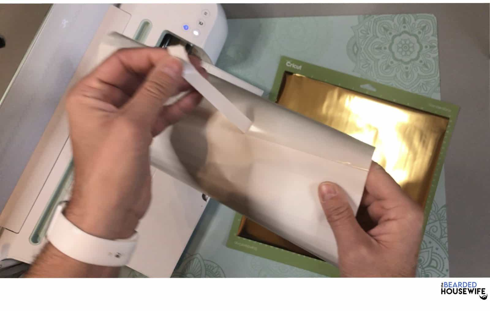 take a piece of tape that is included with your foil
