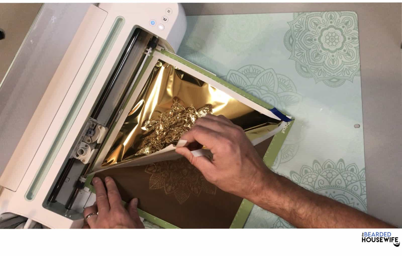 once the foiling is finished, remove the foil carefully. Don't press the arrows to unload the mat.