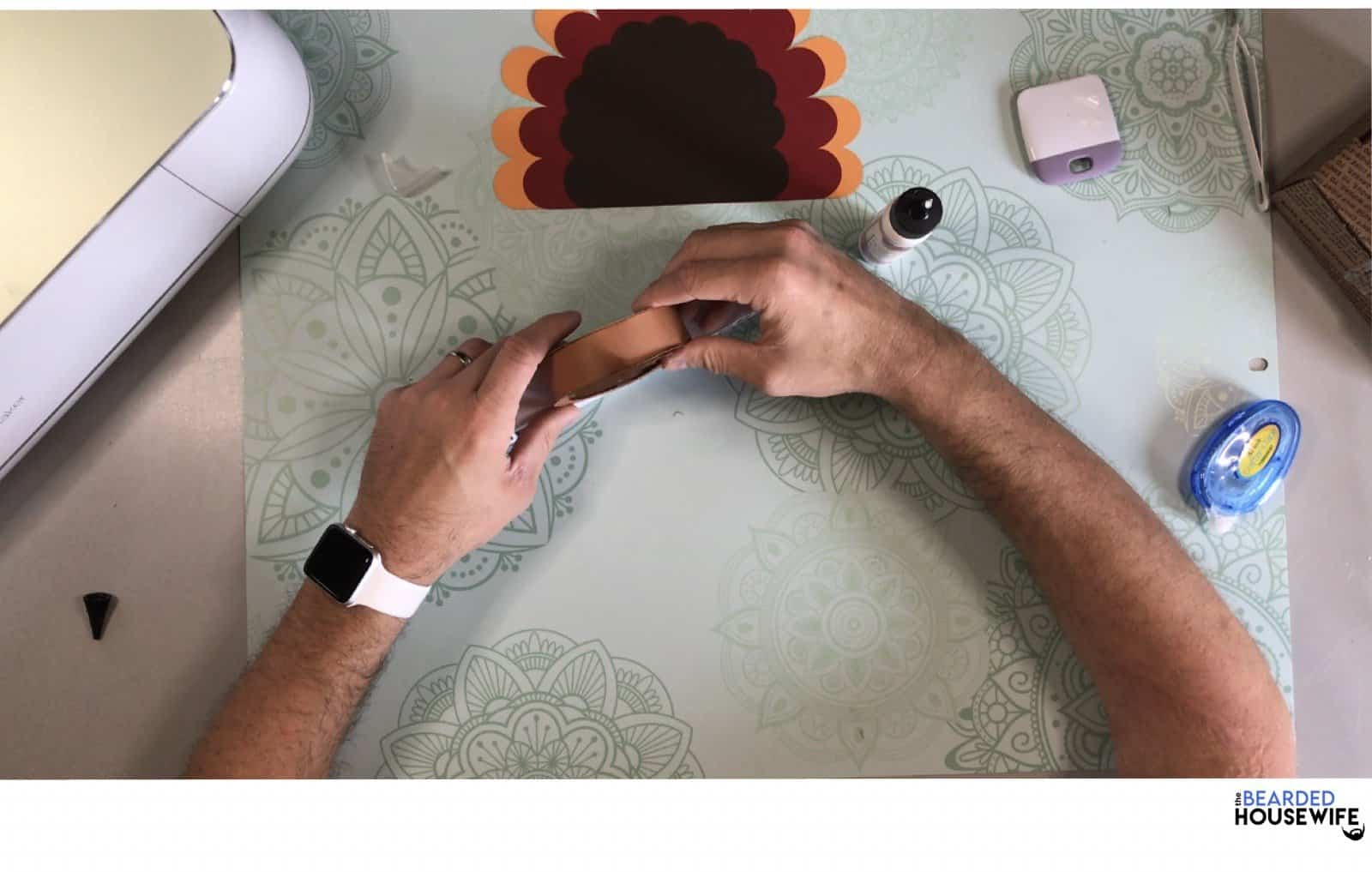 carefully press the turkey into the glue