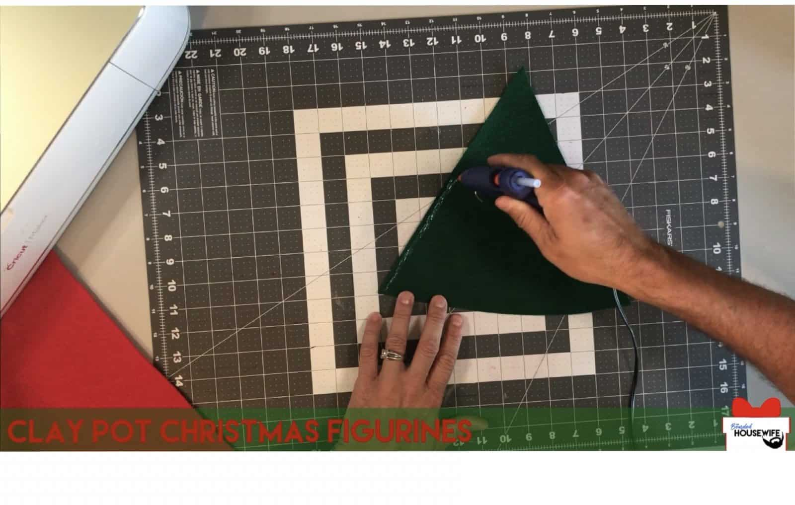 add a ribbon of glue to one side of the felt triangle