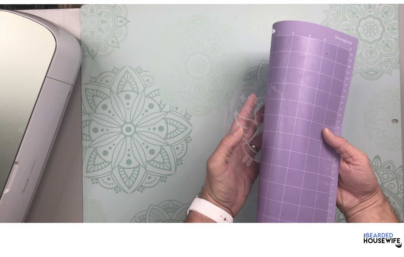 peel the mat away from the acrylic slowly