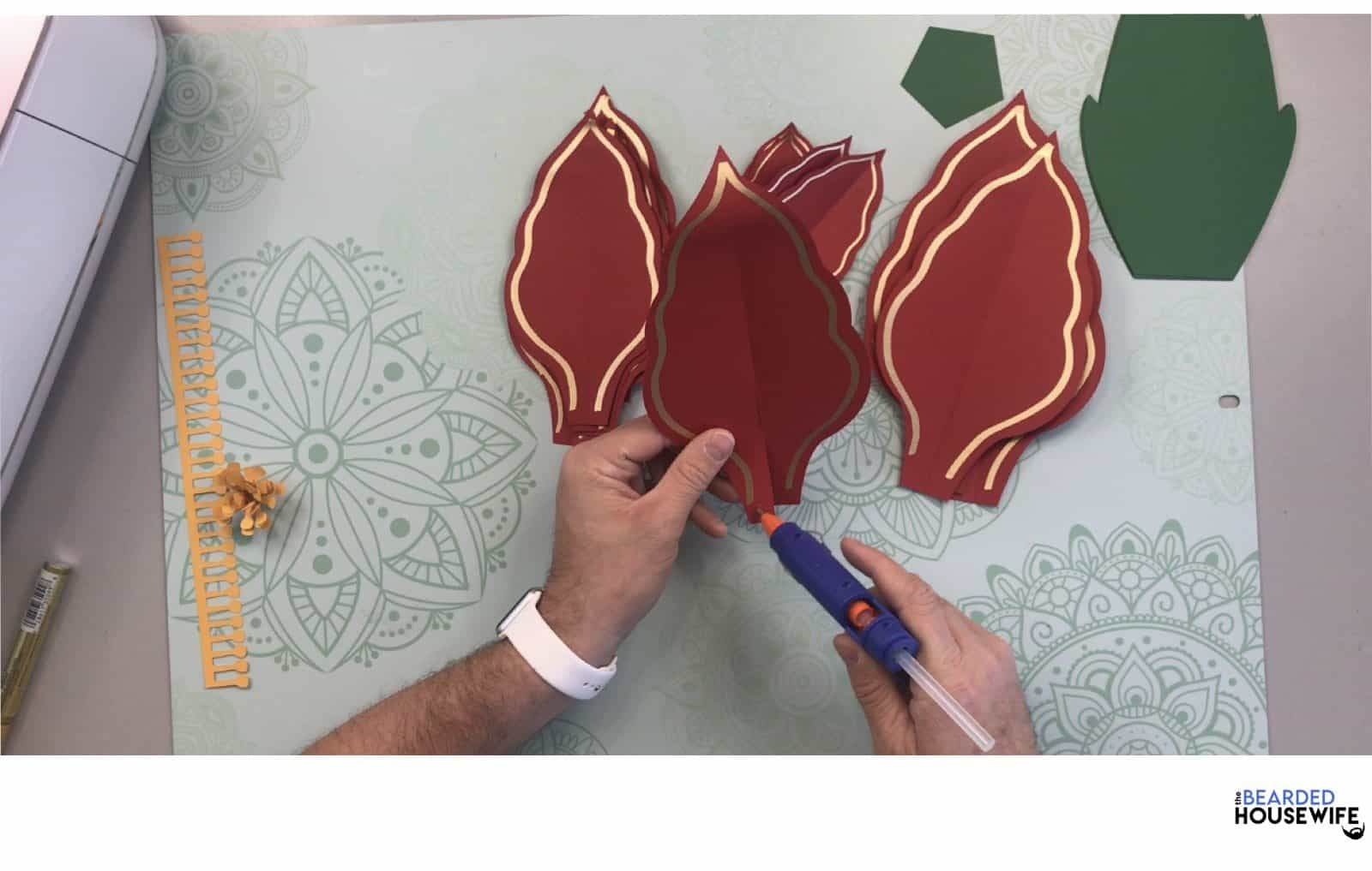 to form your petals, add some hot glue to the bottom left of the petal