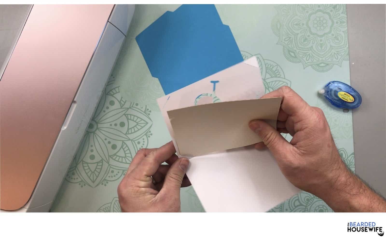 carefully place the insert card into the tabs on the outer card layer