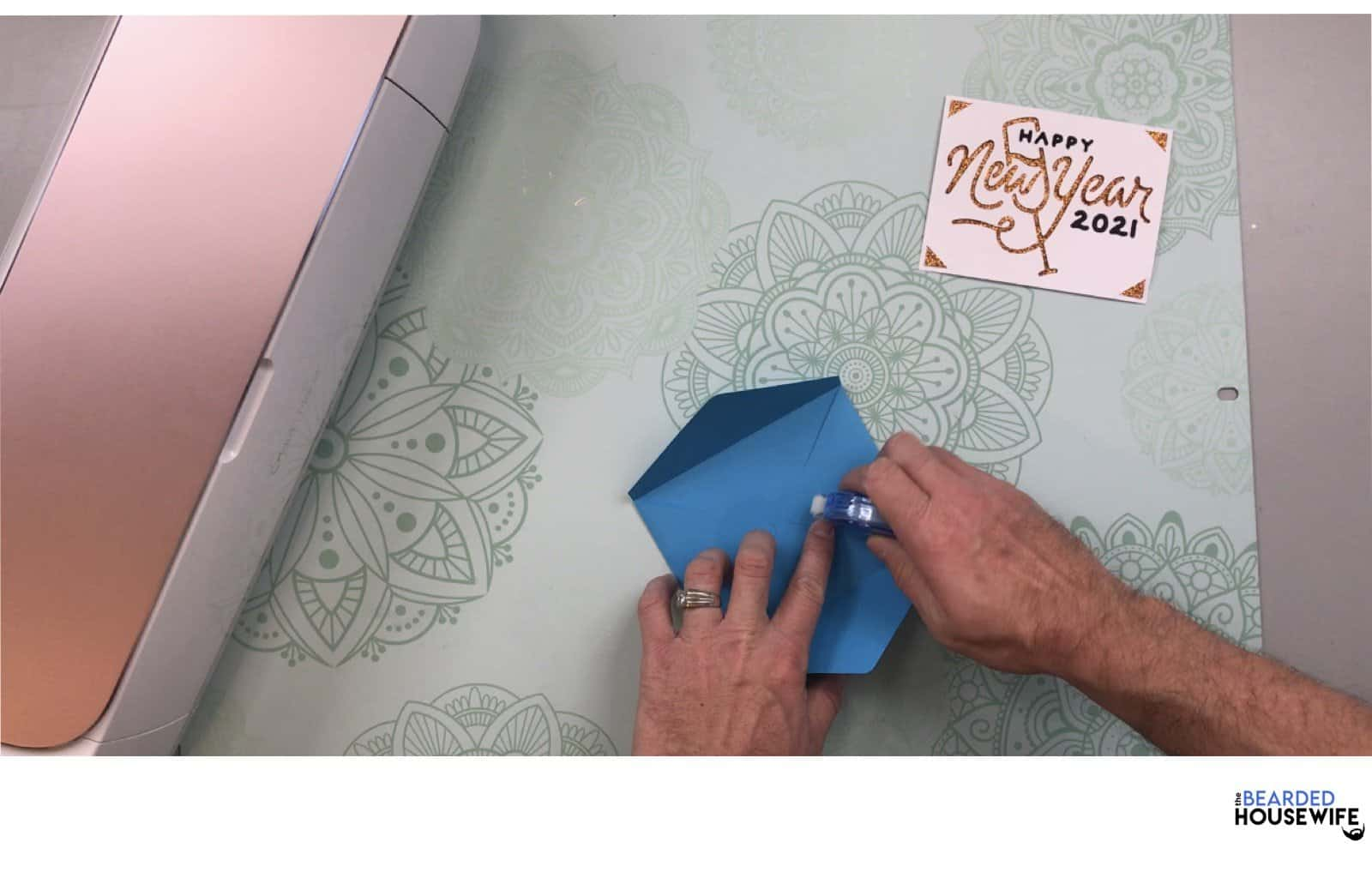 add adhesive to the inner tabs
