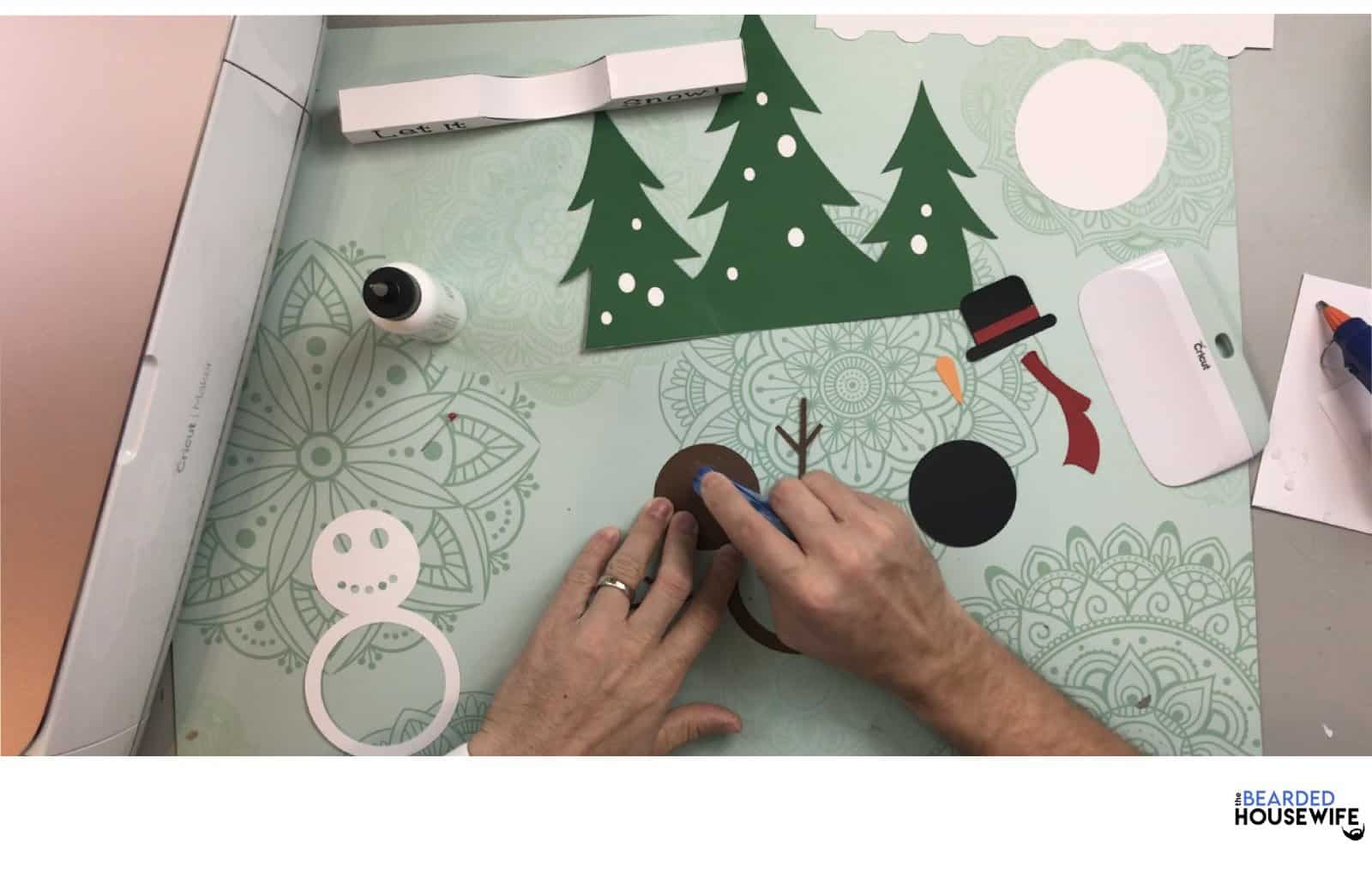 add glue to the brown snowman layer
