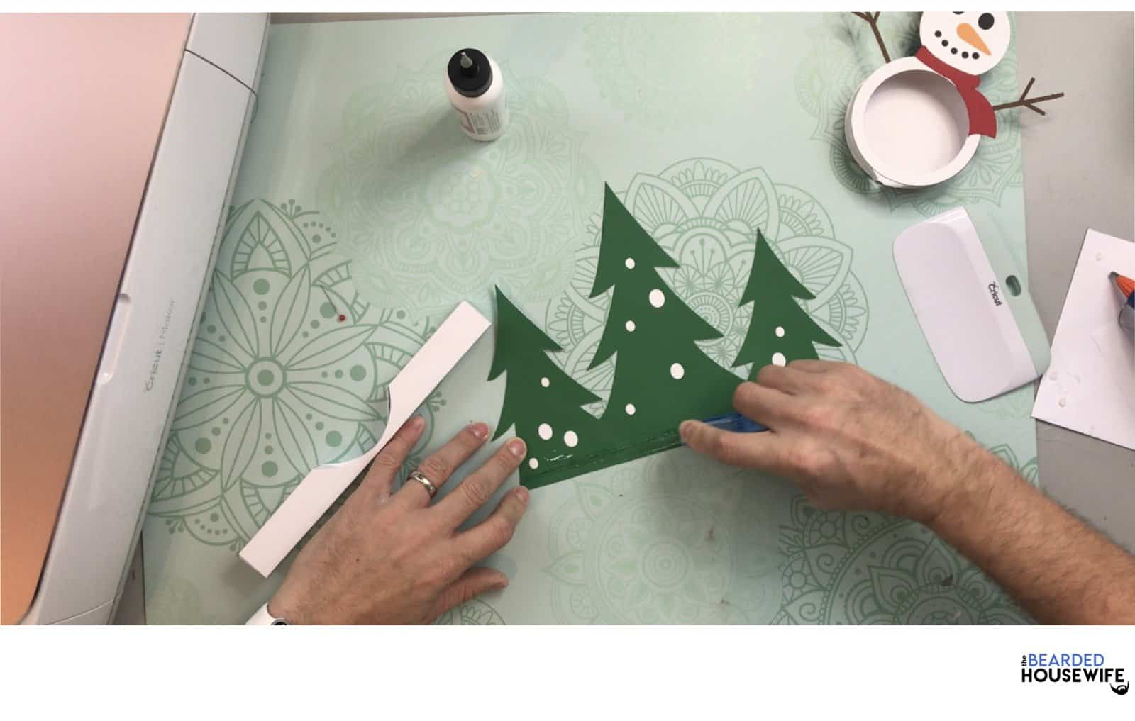 add glue or adhesive to the bottom of the trees
