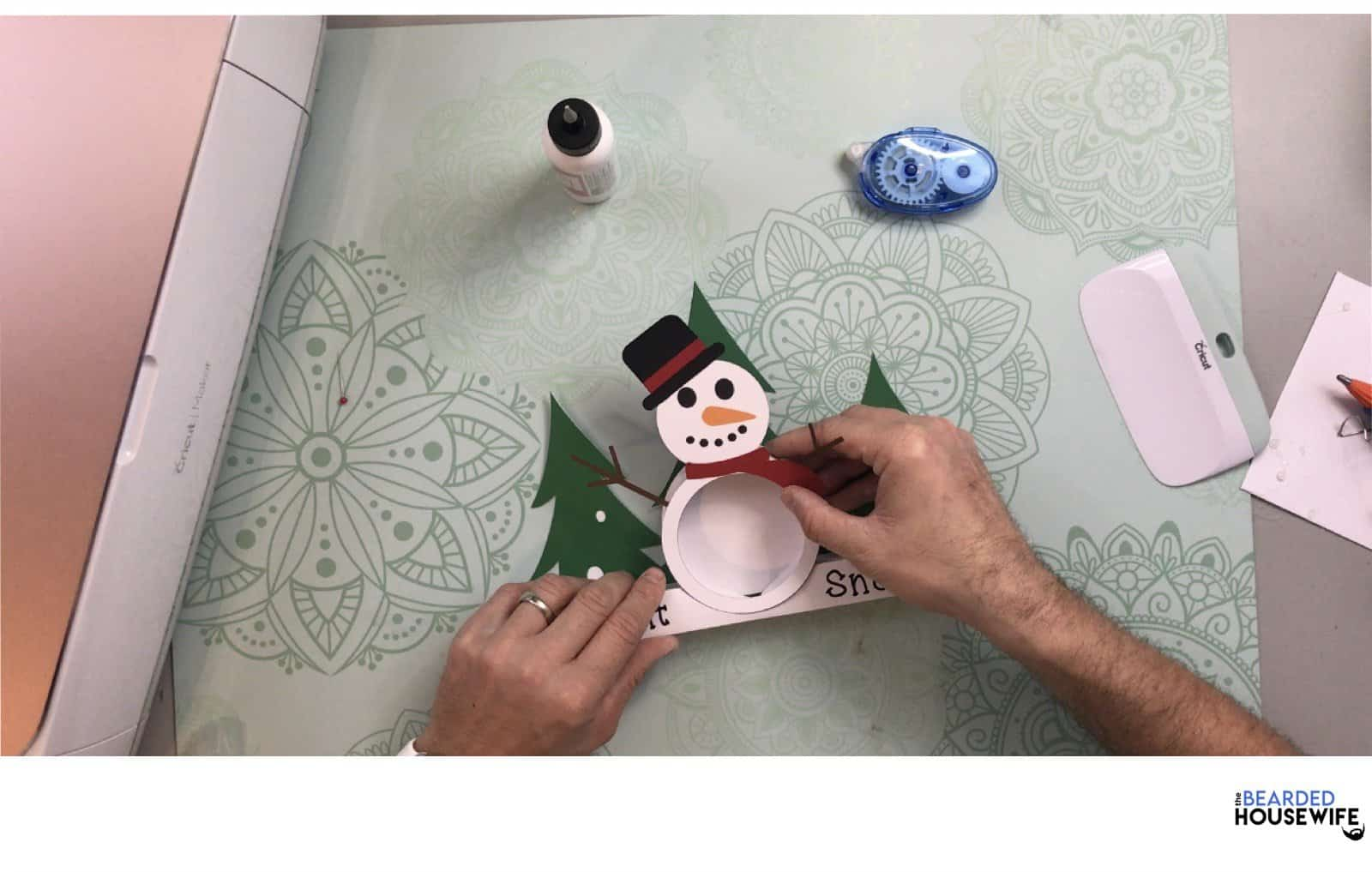gently press and hold the snowman into the bridge securing him into place