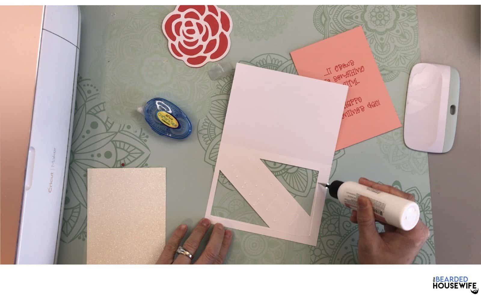 add glue and adhesive to the inner part of the cutout on the outer card