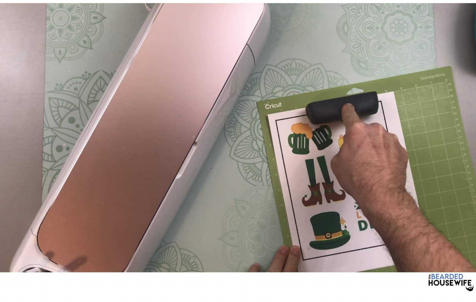 apply your sticker sheet to the cutting mat and use your brayer to make sure it is secure on the mat