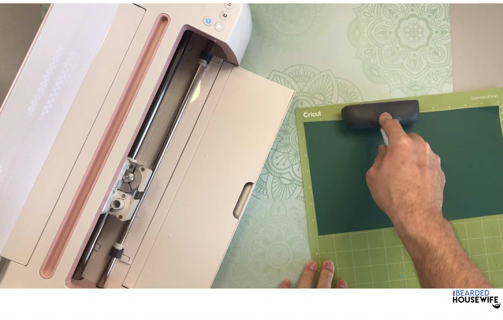 use a brayer to help adhere the vinyl to the mat