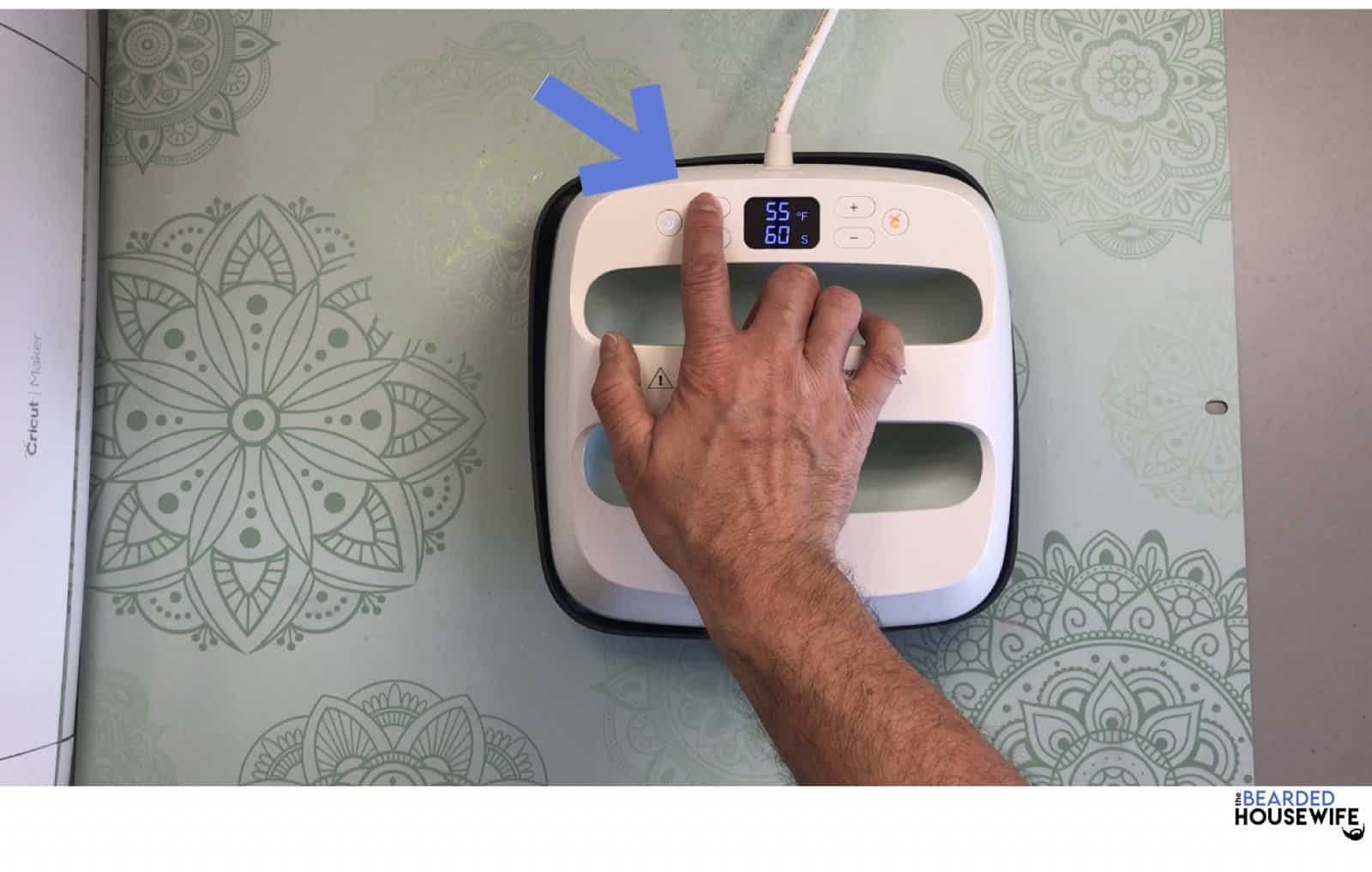 preheat your heat press according to the Cricut Heat Guide's specifications. Press the thermometer to adjust the temp