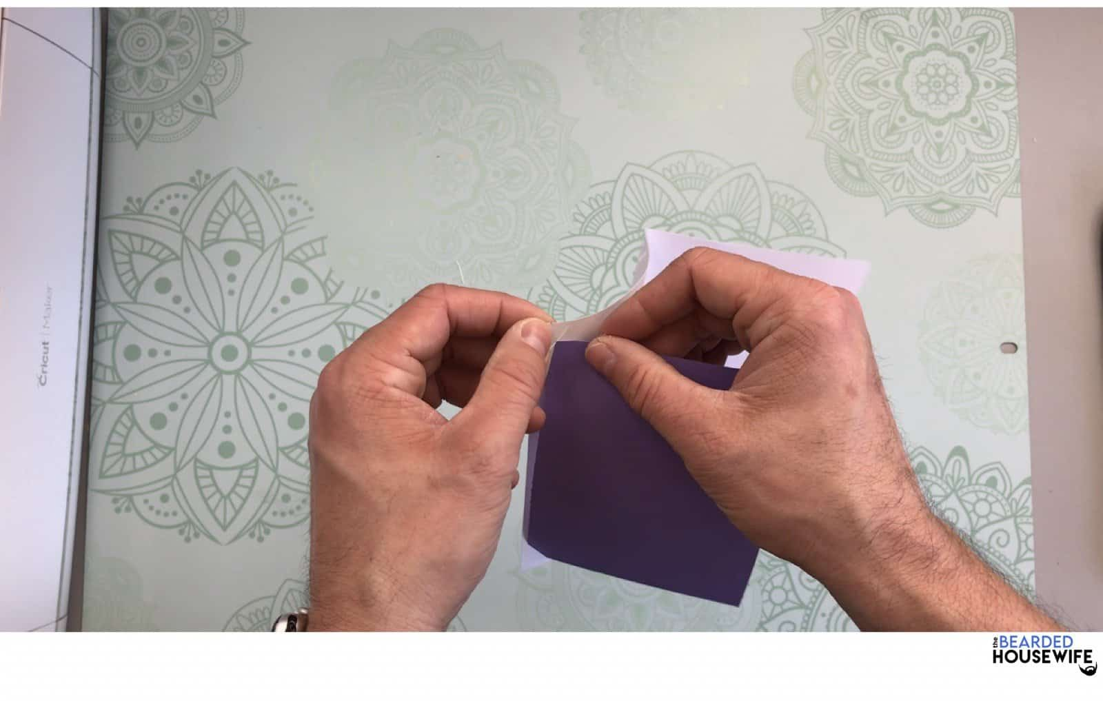 place the insert into the tabs on the outer card layer
