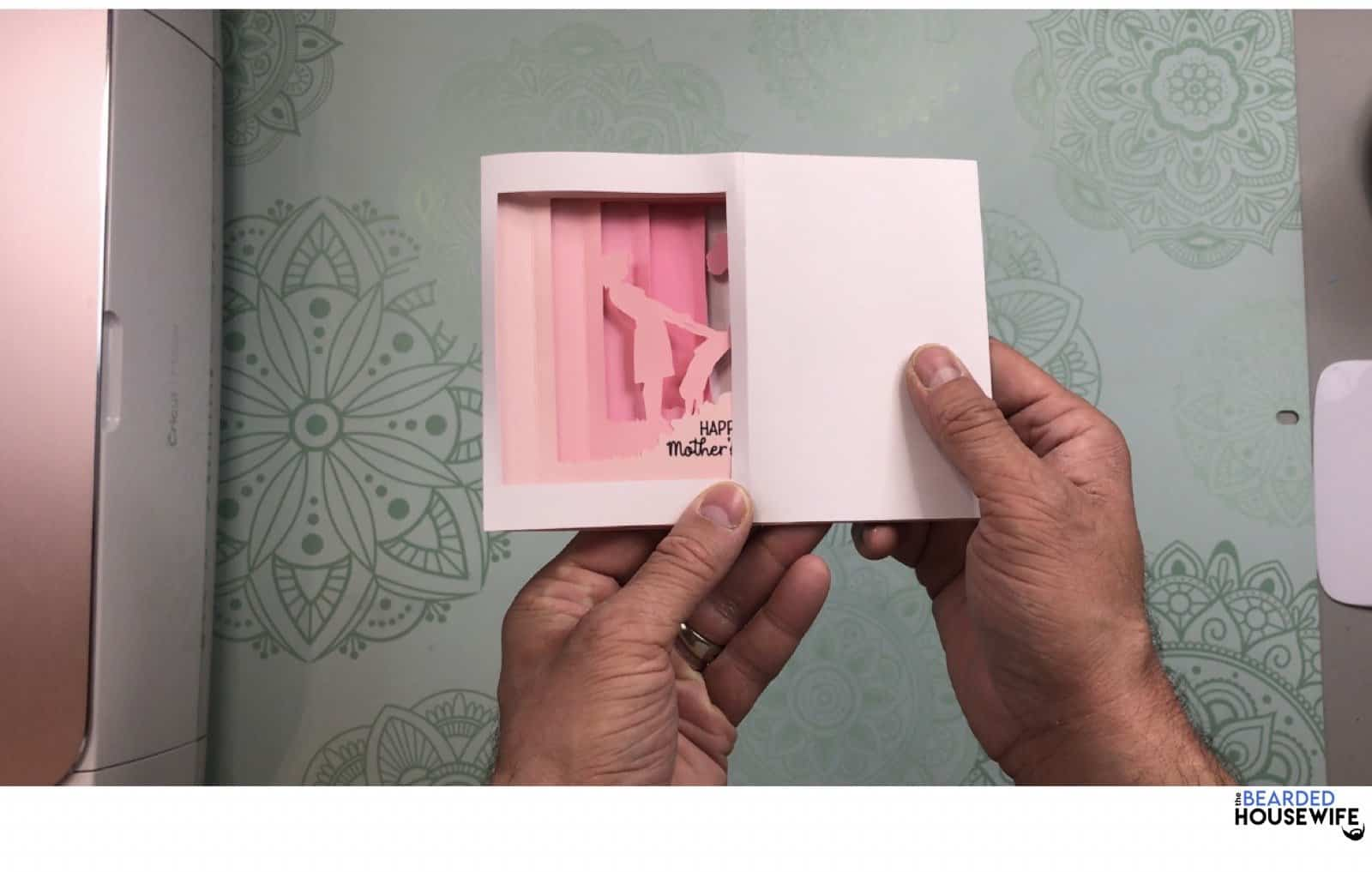 fold the card to the left to place into the envelope