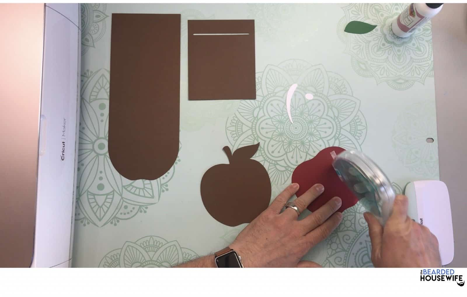 add adhesive to the back of the apple