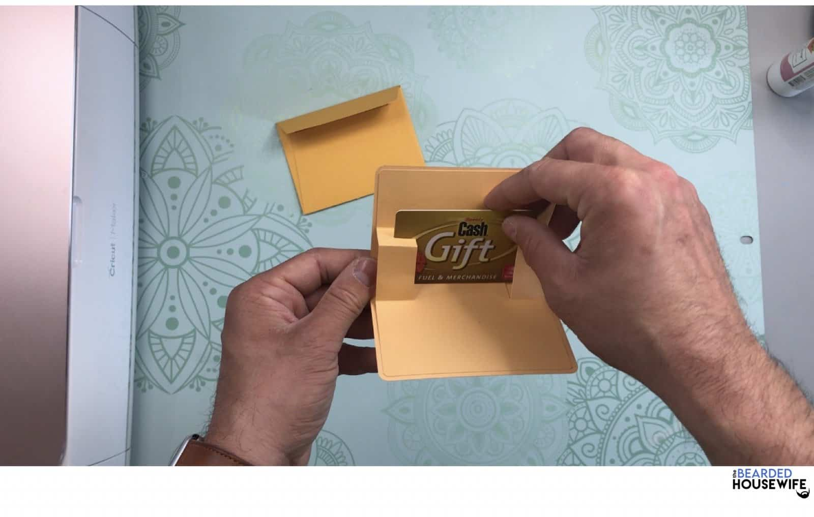 slide your gift card into the slot on the pop-up