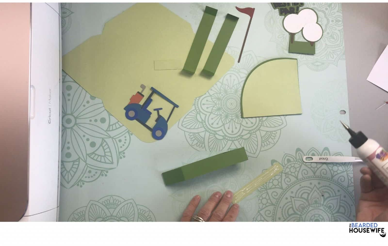 add glue to the inside panels and add along the front and sides of the box