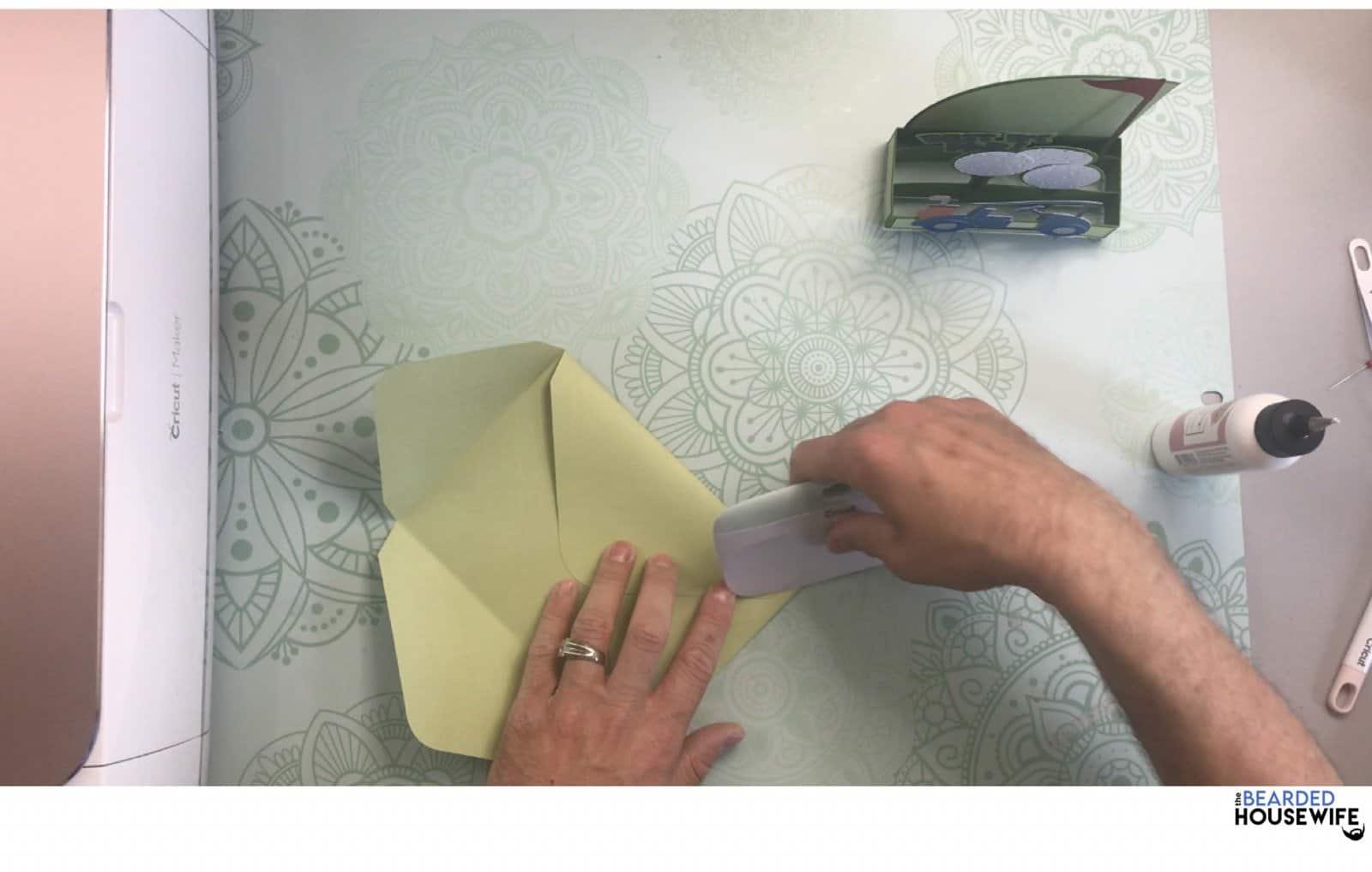 use your scraper to press the fold
