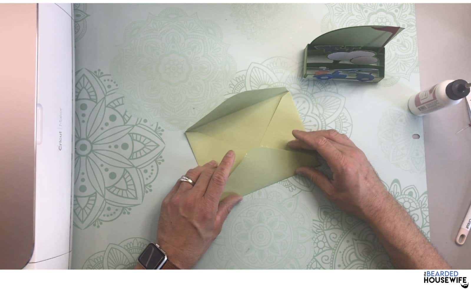 bring the bottom flap up to form the envelope