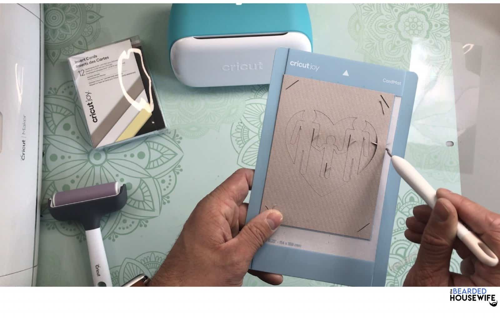 use the weeding tool to loosen one side of the card
