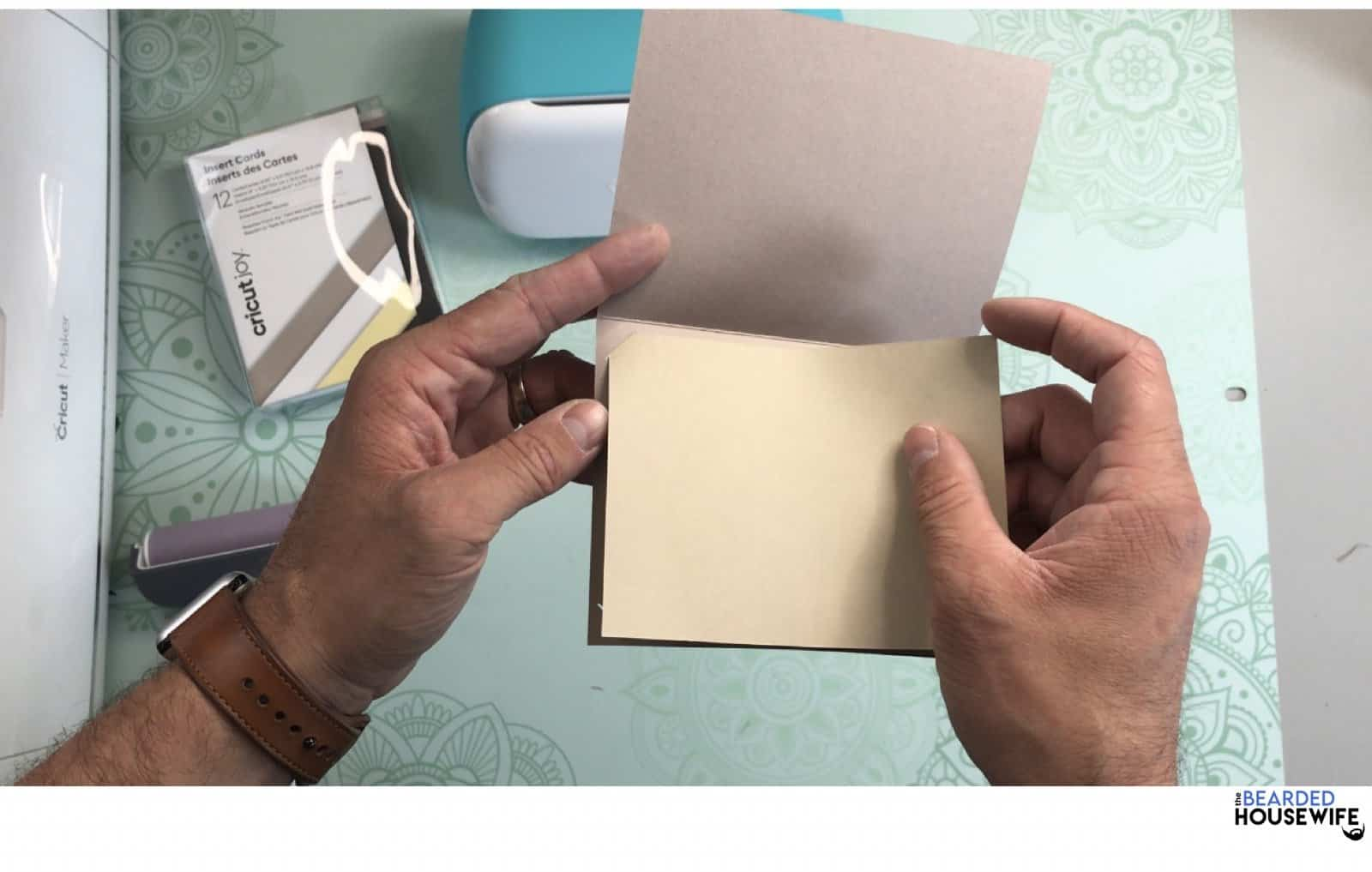 place the insert into the tabs on the outer card