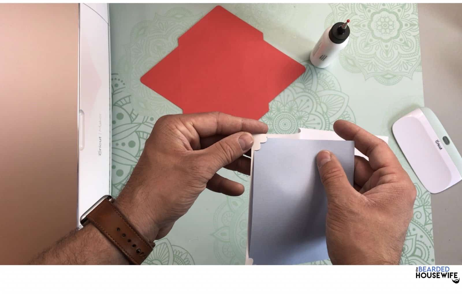 place the insert into the slits on the outer card layer