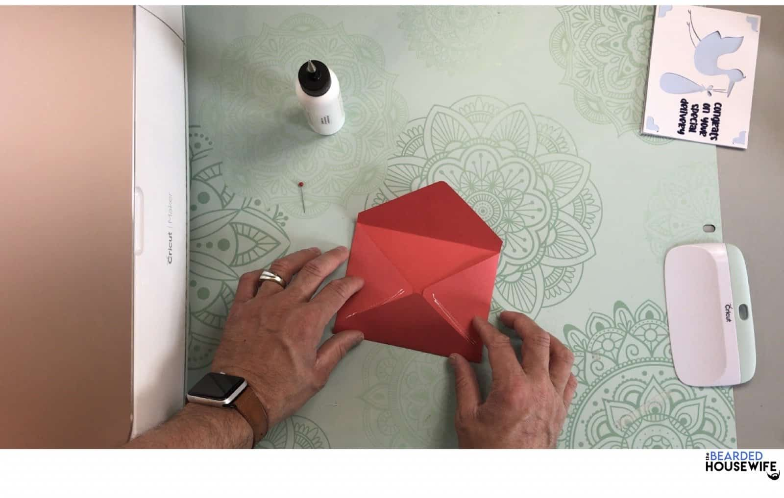 bring the bottom flap up and press to form the envelope