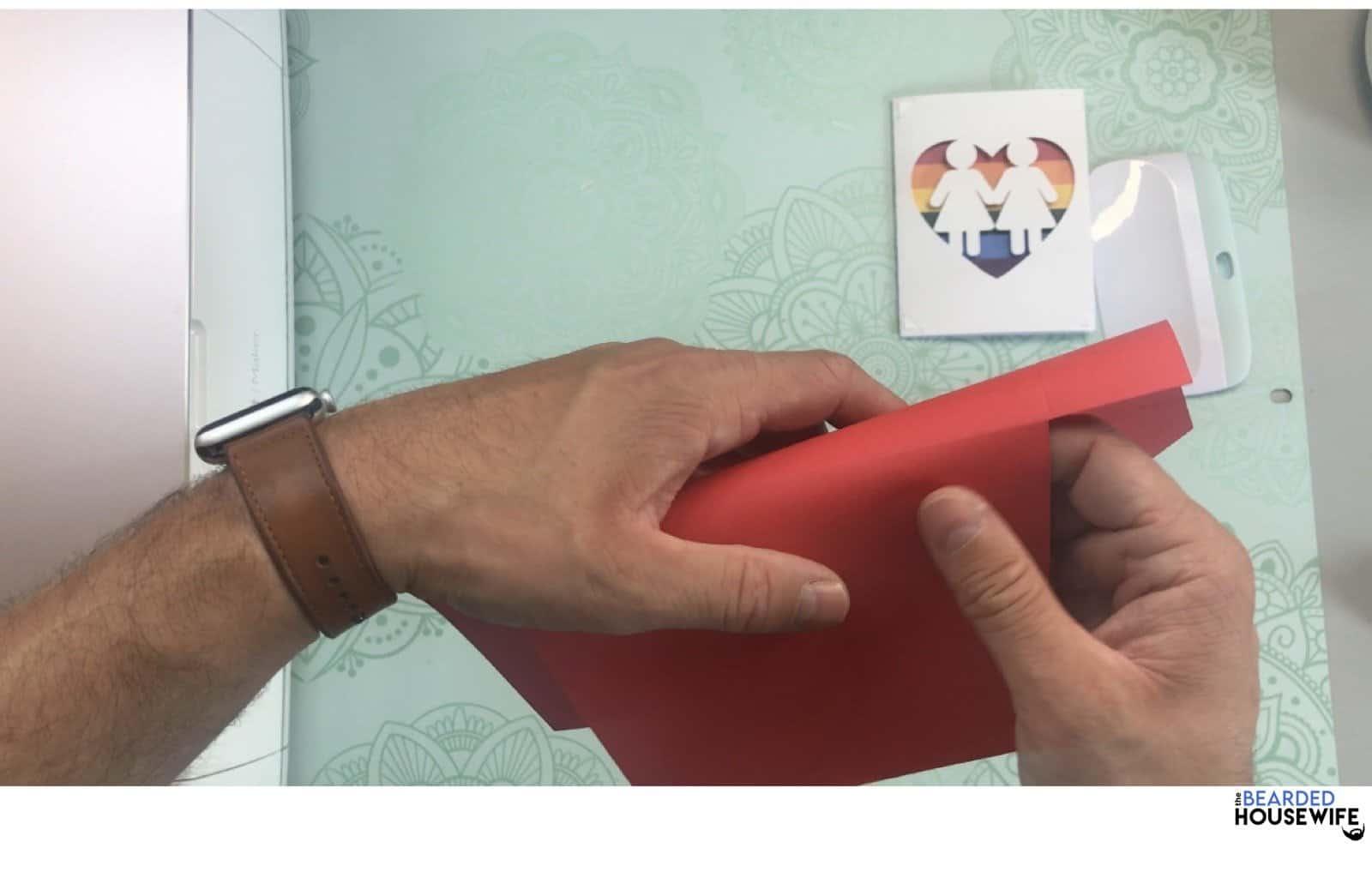 fold the envelope along the score line