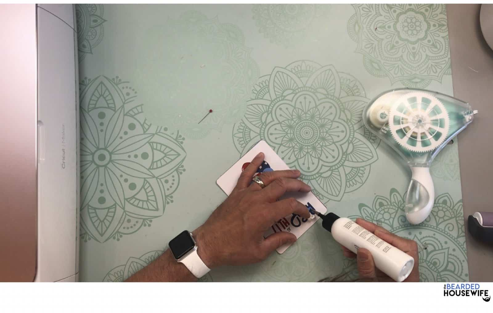 add glue to any areas that may not be adhered