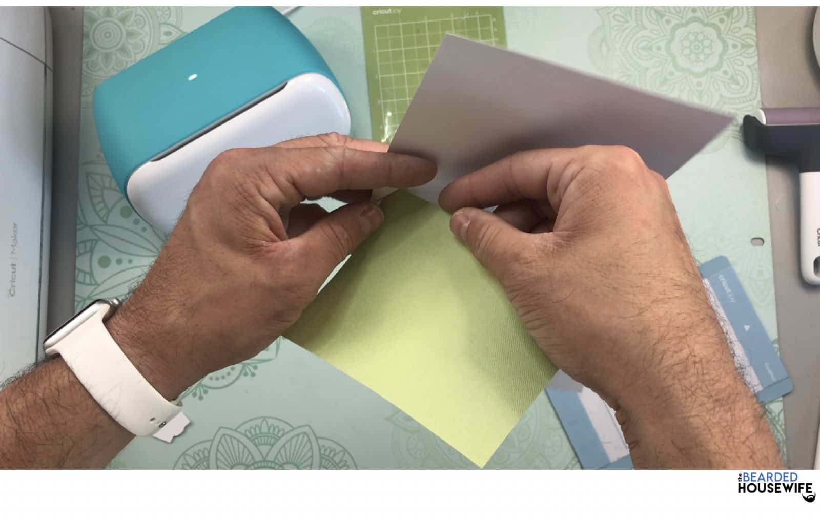 place the insert into the slits on the outer card