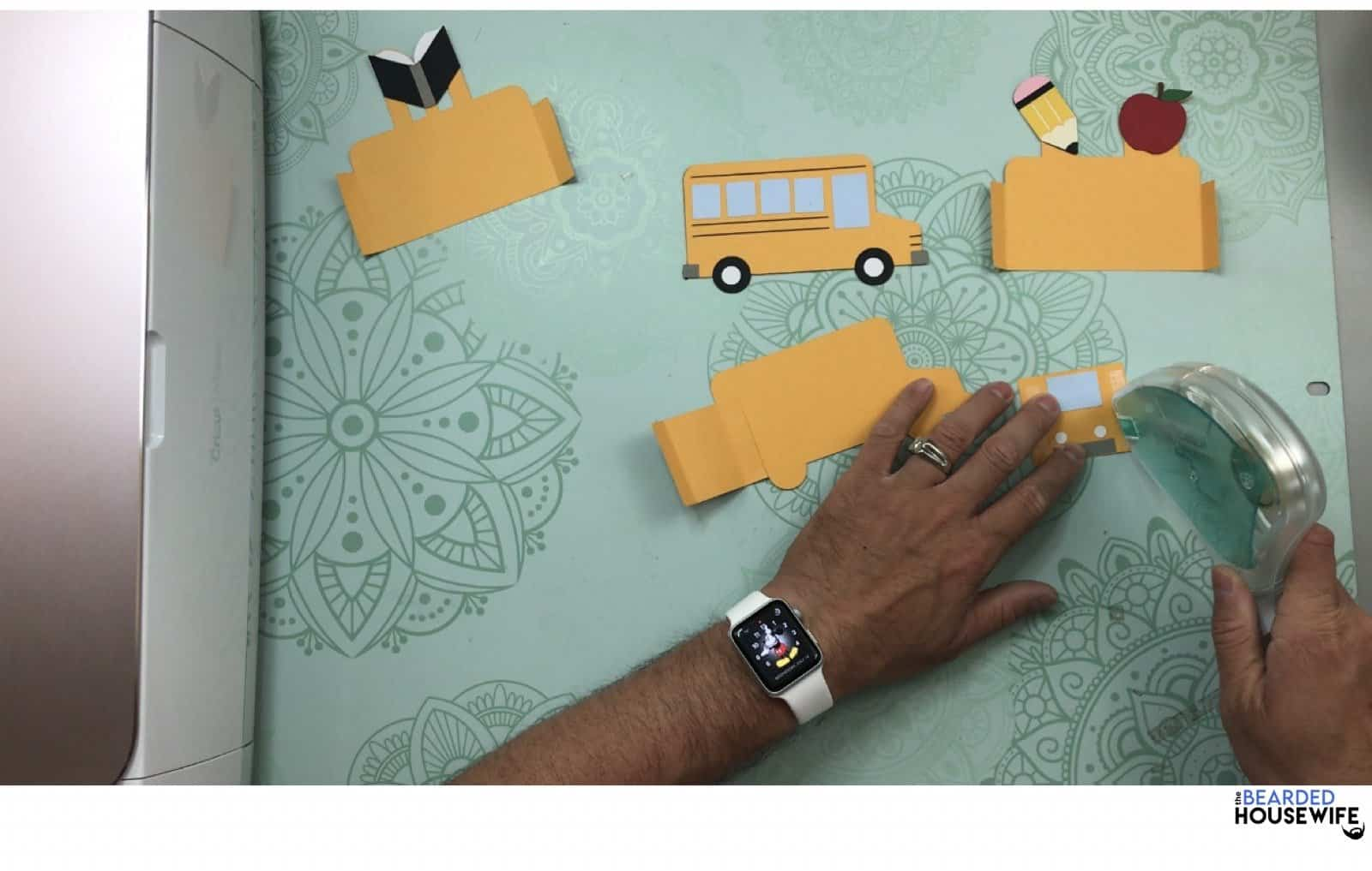 add adhesive to the right side of the front of the bus
