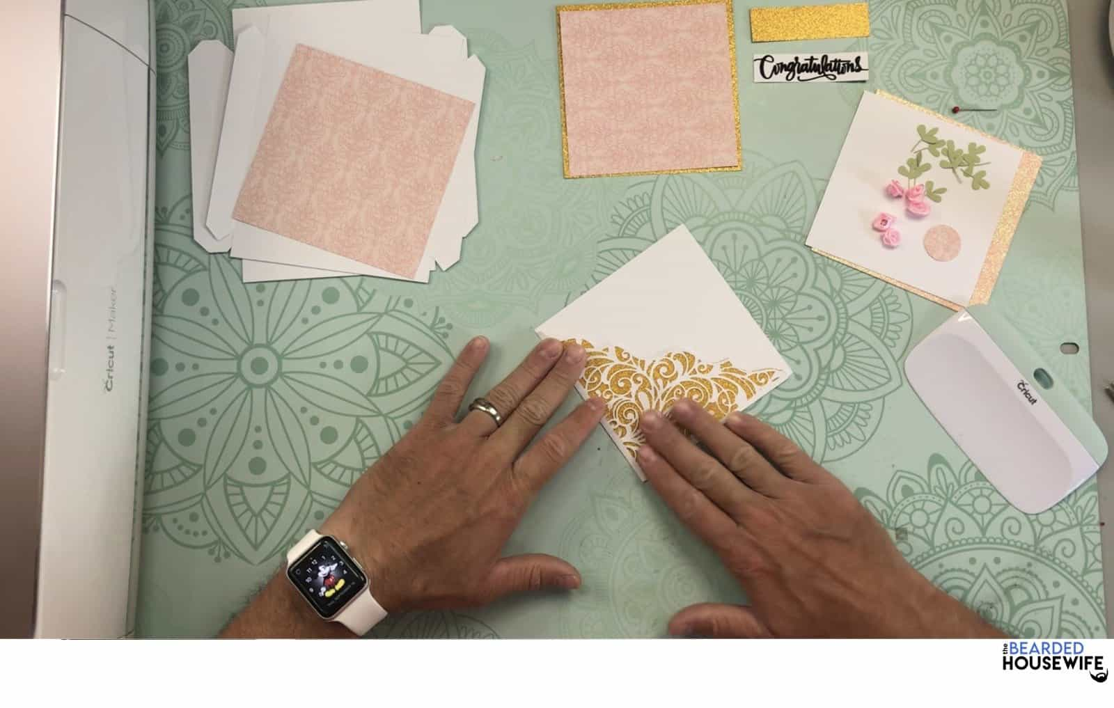 give the card a press with your hand to ensure the glue has adhered well