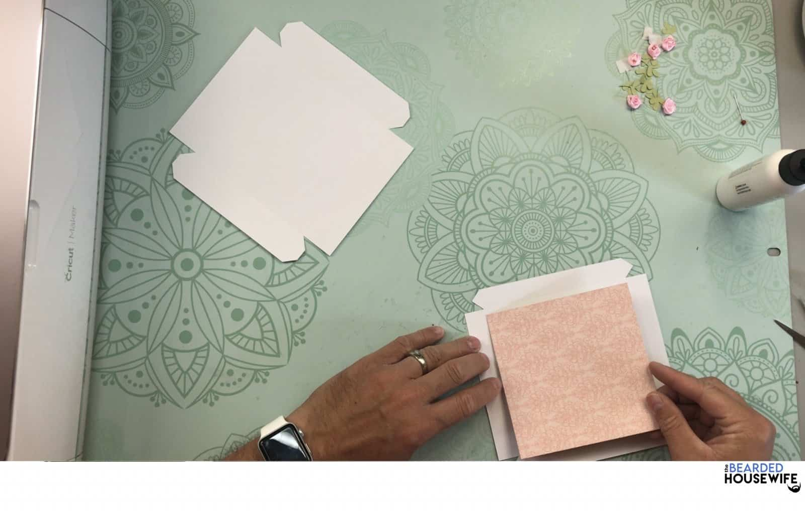 add the patterned paper to the top of the box lid