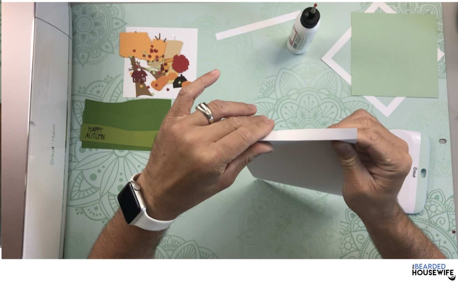 begin by folding one side of the card base in an accordian style with the first tab facing away from you