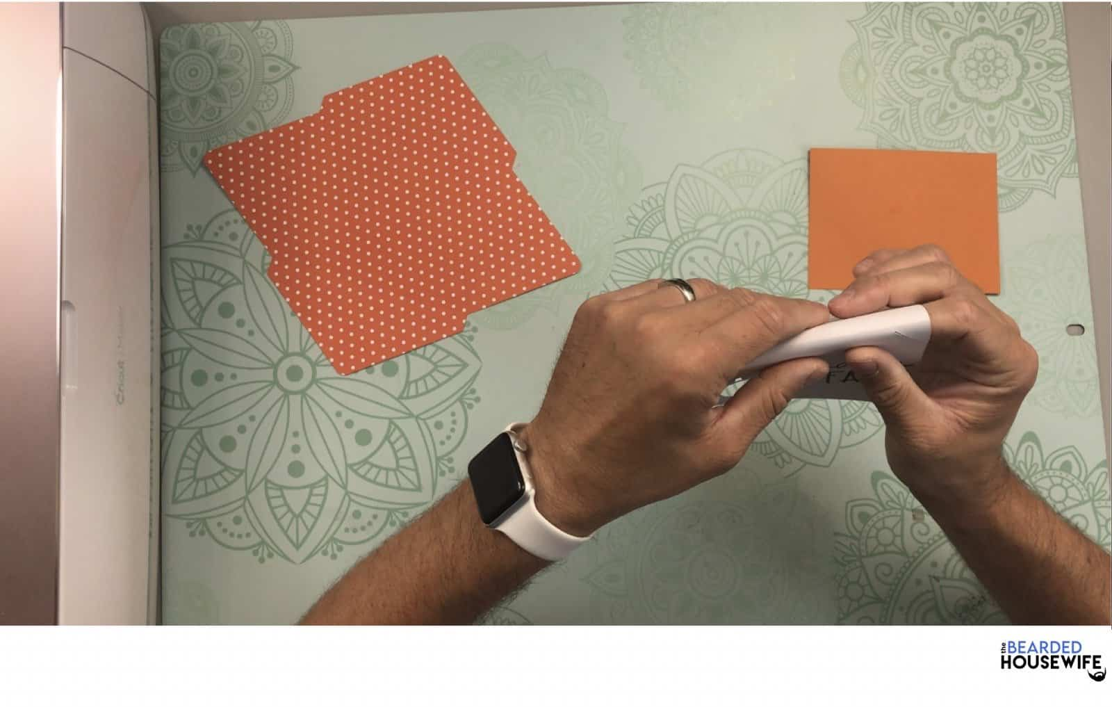 begin by folding the card along the score line