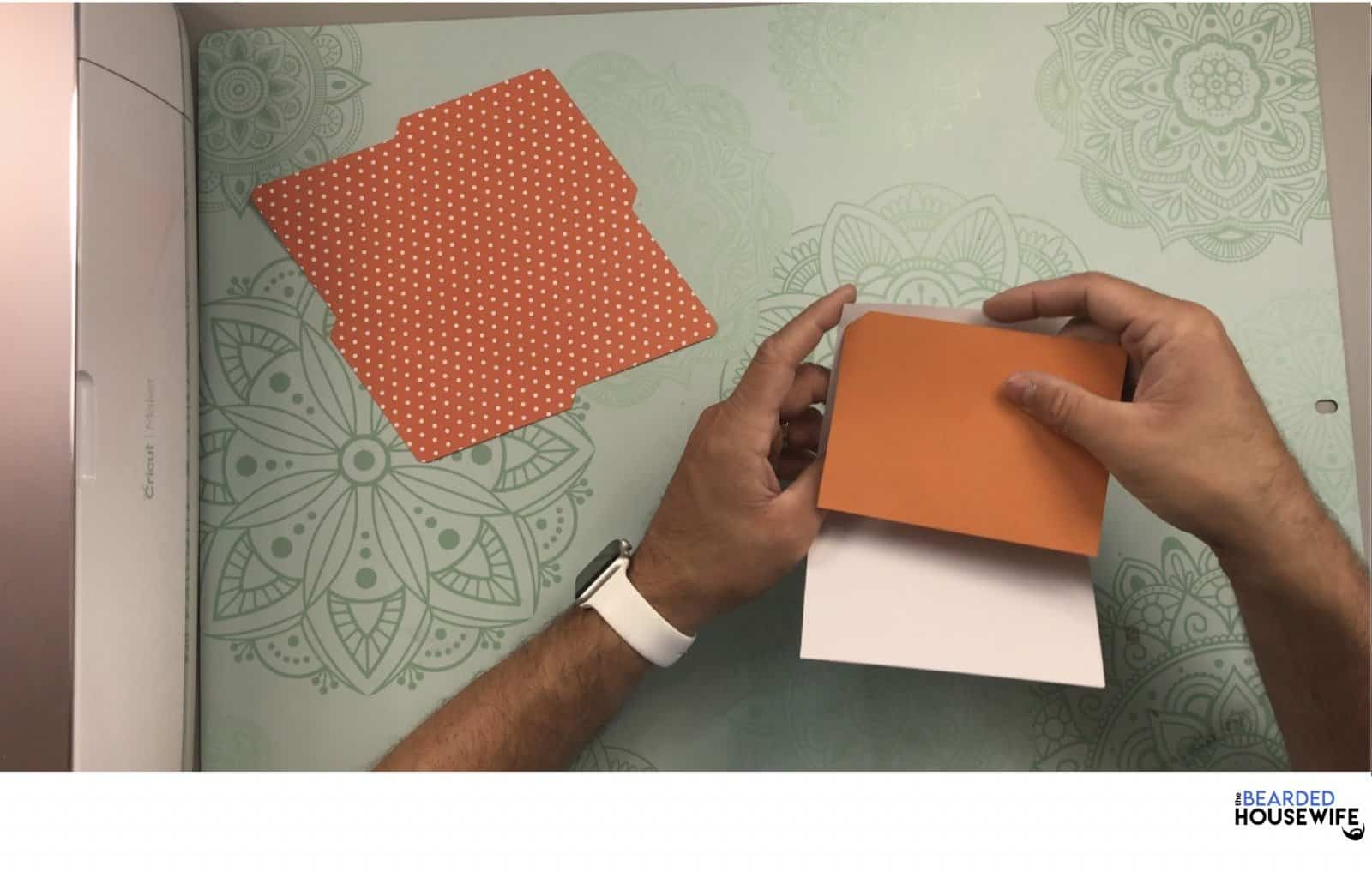 place the insert layer into the slits on the outer card