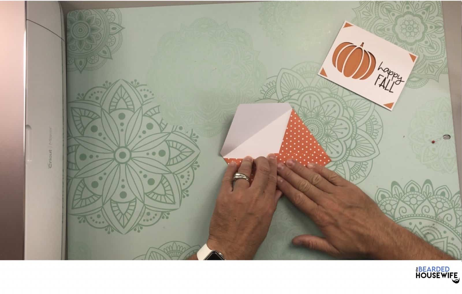 bring the bottom flap up and form the envelope
